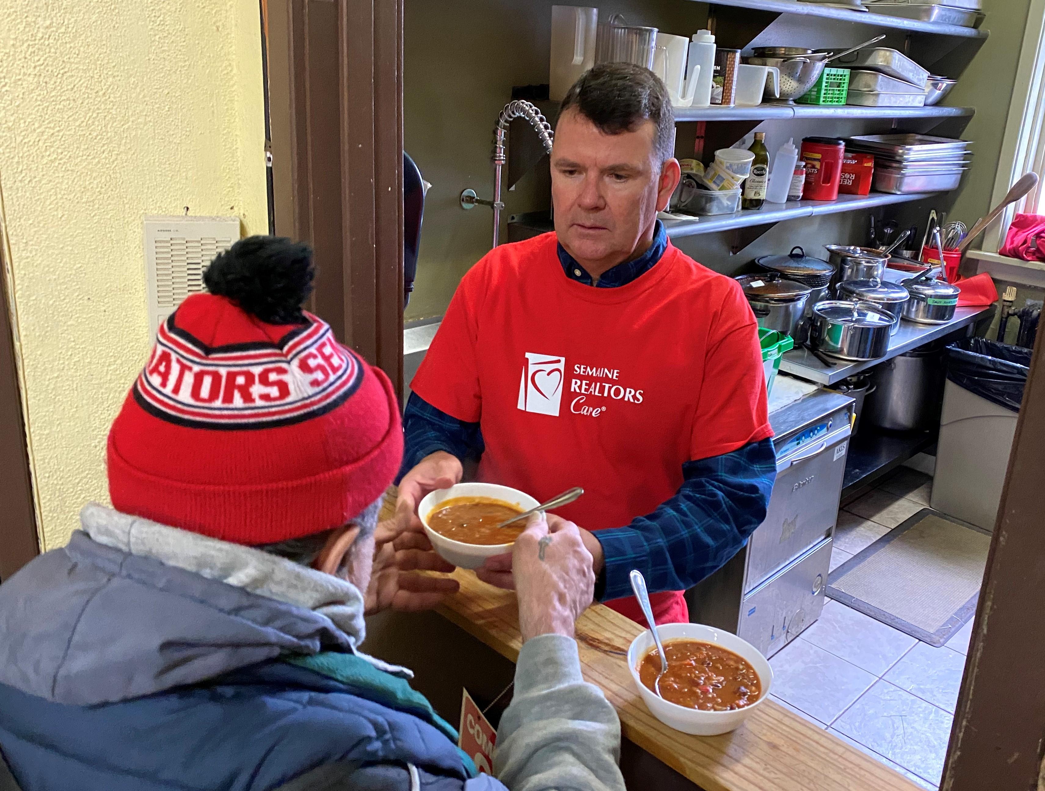 CREA CEO helps serve chili lunch at Centre 507