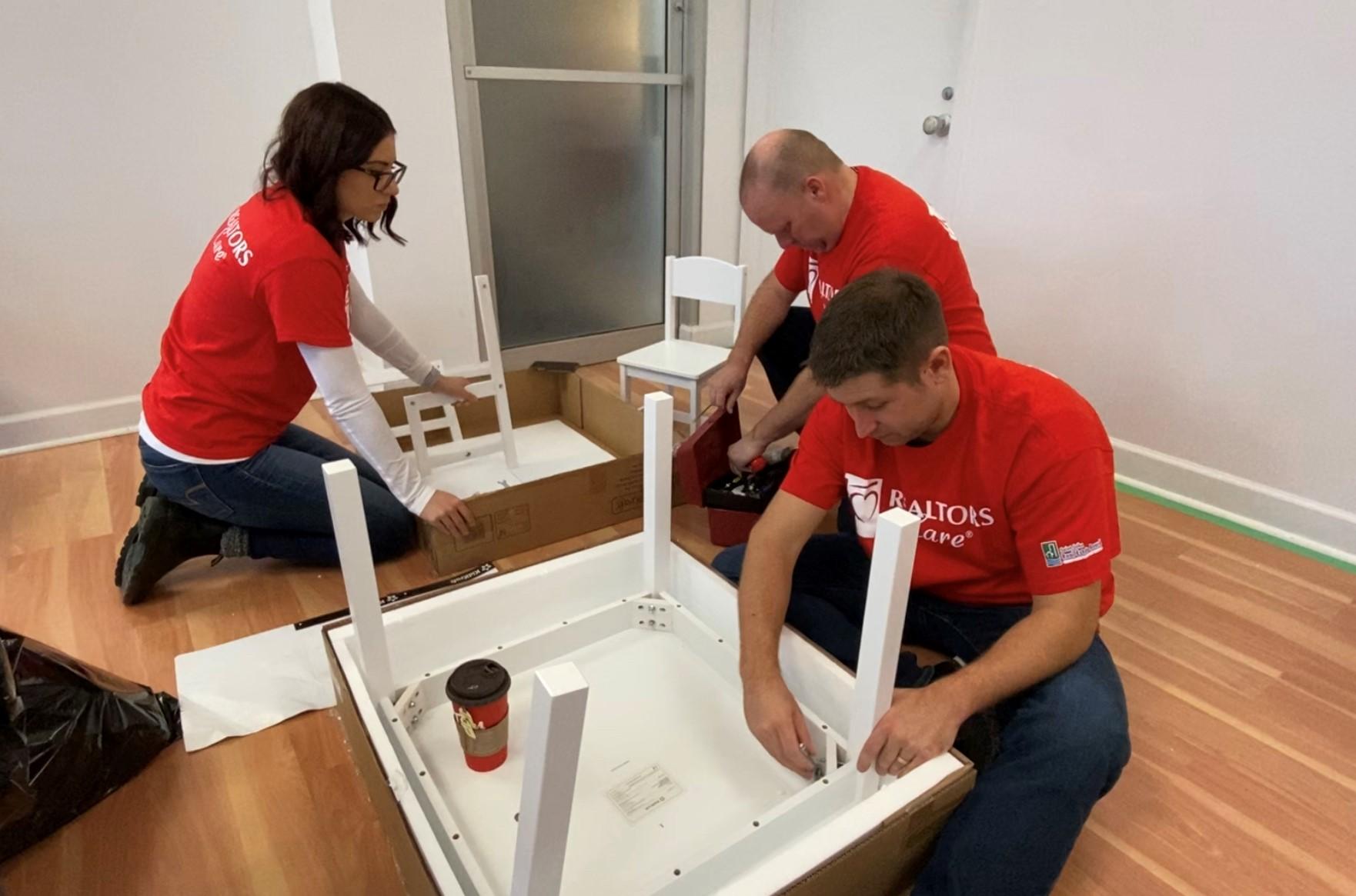 REALTOR members assembling furniture